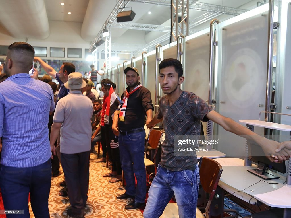 Supporters of Shiite cleric Muqtada al-Sadr storm parliament in Baghdad's Green Zone on April 30, 2016. Thousands of protesters carrying Iraqi flags and chanting anti-government slogans broke into Baghdad's Green Zone and stormed the parliament building.
