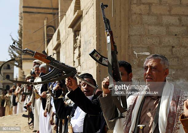 Supporters of Shiite Huthi rebels and militiamen raise their weapons during a rally against the Saudiled coalition which has been leading the war...