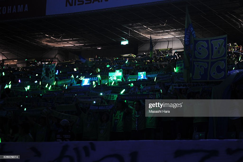 Supporters of Shonan Bellmare cheer prior to the J.League match between Yokohama F.Marinos and Shonan Bellmare at the Nissan stadium on April 30, 2016 in Yokohama, Kanagawa, Japan.