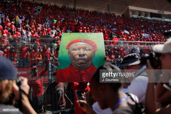 Supporters of South African presidential candidate Julius Malema cheer as a painting of Julius Malema is displayed during an Economic Freedom...
