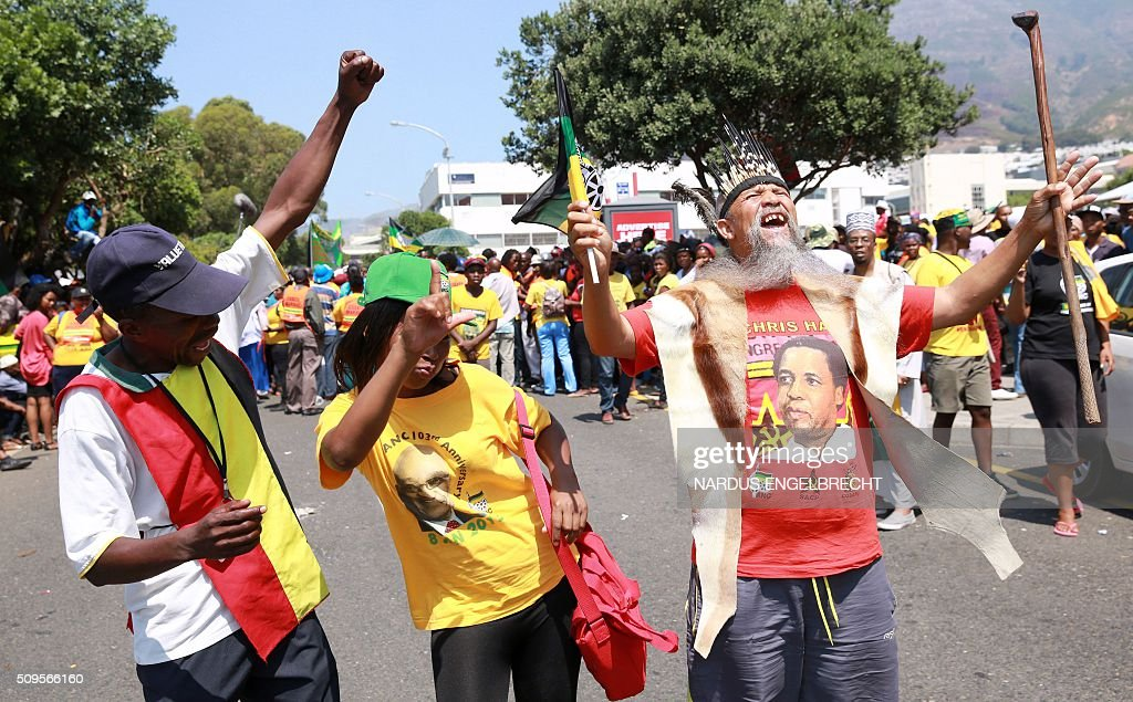 Supporters of South Africa's African National Congress ruling party and President Jacob Zuma show their support for the president on February 11, 2016, in Cape Town, South Africa few hours ahead of his State of the Nation address. Police manned razor wire barricades outside the South African parliament on February 11 ahead of President Jacob Zuma's address to the nation against a background of concerted efforts to oust him from office. The embattled president faces moves in court, in parliament and on the streets to have him impeached or dumped by the ruling African National Congress (ANC). ENGELBRECHT