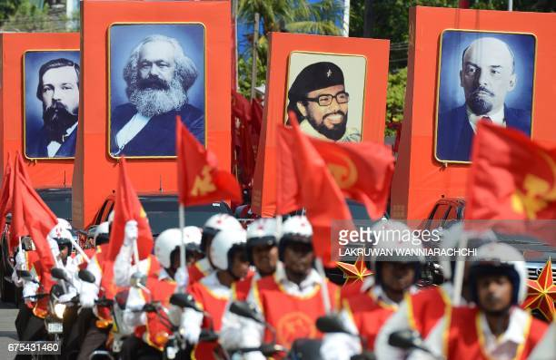 Supporters of Sri Lanka's JVP also known as the People's Liberation Front display placards with images of Friedrich Engels Karl Marx the late JVP...