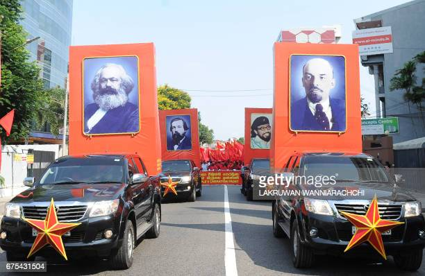 Supporters of Sri Lanka's JVP also known as the People's Liberation Front display placards with images of Karl Marx Friedrich Engels the late JVP...