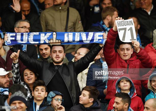 Supporters of SSC Napoli show some scarves against Gonzalo Higuain before the Serie A match between SSC Napoli and Juventus FC at Stadio San Paolo on...