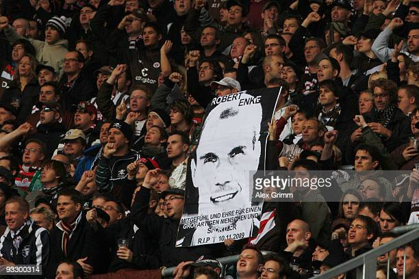 Supporters of St Pauli hold up a placard to commemorate Robert Enke during the Second Bundesliga match between FC Augsburg and FC St Pauli at the...