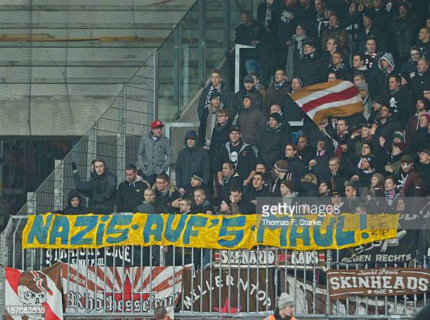 Supporters of St Pauli show a banner against Nazis in the colours of Braunschweig during the Second Bundesliga match between Eintracht Braunschweig...
