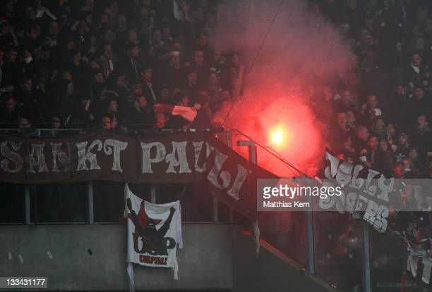 Supporters of St Pauli with pyrotechnic articles are pictured during the Second Bundesliga match between FC Hansa Rostock and FC St Pauli at DKB...