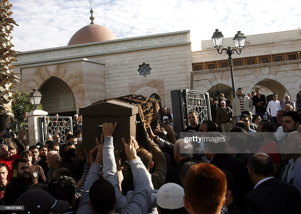 Supporters of Sunni Salafi Sheikh Ahmed al-Assir carry a casket during a funeral in the southern Lebanese port city of Sidon, on November 12, 2012. Three people were killed in Sidon in a gunbattle between supporters of the Shiite group Hezbollah and a hardline Sunni cleric, a security official said.