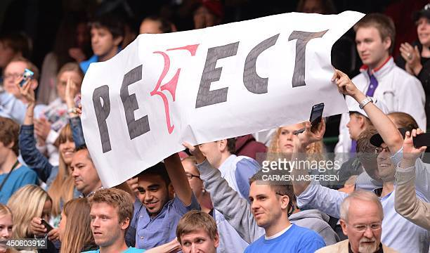 Supporters of Swiss Roger Federer hold a placard reading 'Perfect' after Federer's semifinal match against Kei Nishikori from Japan at the ATP Gerry...