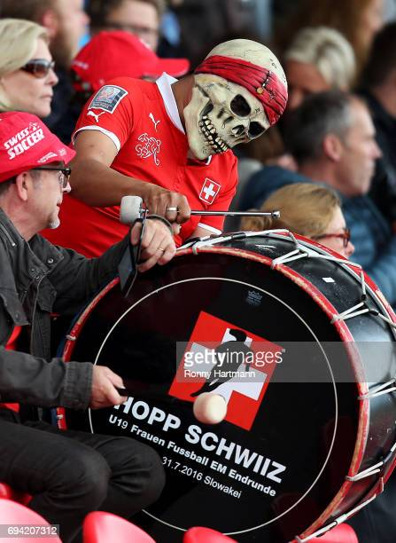 Supporters of Switzerland cheer during the U19 women's elite round match between Germany and Switzerland at Friedensstadion on June 9 2017 in...