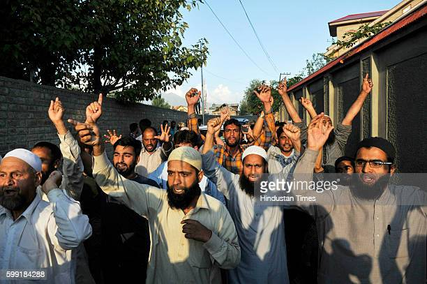 Supporters of Syed Ali Geelani the Chairman of All Parties Hurriyat Conference raise profreedom slogans in front of the cavalcade of the all party...