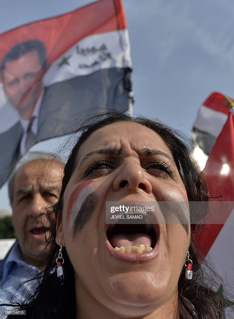 Supporters of Syrian President Bashar Al-Assad shout during a demonstration in front of the White House in Washington, DC, on September 9, 2013 urging US not to attack Syria. US Presidents Barack Obama and Bashar Al-Assad will go head-to-head in dueling US television interviews Monday, as a crucial week dawns for the US leader's push for air attacks on Syria. Assad denied that he used chemical weapons on civilians, as Obama makes a long-odds push to reverse his nation's mood and win support for punishing the Damascus regime for flouting taboos on the use of such arms. AFP Photo/Jewel Samad