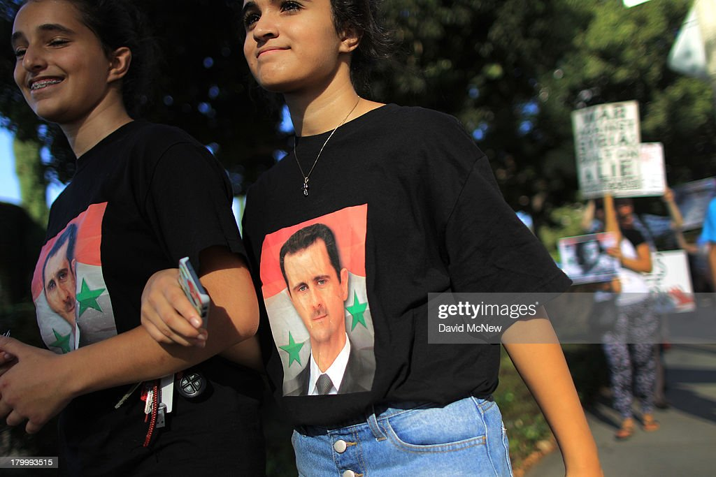 Supporters of Syrian President Bashar Hafez al-Assad wear shirts bearing his image at a rally to urge Congress to vote against a limited military strike against the Syrian military in response to allegations that Assad has used sarin gas to kill civilians on September 7, 2013 in Los Angeles, California. The Obama administration claims to have clear evidence that the Syrian military broke international law by killing nearly 1,500 Syrian civilians, including at least 426 children, in a chemical weapons attack on August 21, and is seeking the support of Congress for a missile strikes to prevent future chemical weapons attacks by the regime and other nations.