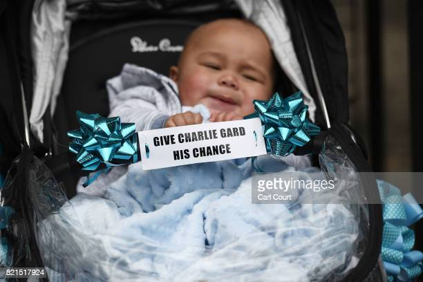 Supporters of terminally ill baby Charlie Gard protest outside the High Court before the verdict was announced on July 24 2017 in London England The...