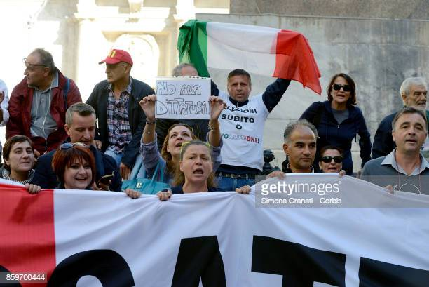 Supporters of the 5 Star Movement protest before the Parliament with a sign No Dictatorship against the electoral law called Rosatellum Bis under...
