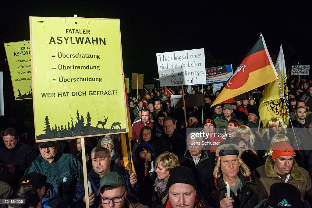Supporters of the AfD (Alternative fuer Deutschland, or Alternative for Germany) in Thuringia, take part at the first AfD Thuringia rally since the Cologne sex attacks on January 13, 2016 in Erfurt, Germany. Hoecke, who is on the far-right wing of the AfD, is demanding an immediate closure of Germany's borders to refugees and the expulsion of foreigners with criminal records. Over 500 women have filed charges including molestation, in some cases robbery and even rape following the gathering of hundreds of North African men, many of them were from Morocco and Algeria, at Cologne's Hauptbahnhof main railway station on New Year's Eve. The incident has caused heated discussion in Germany over the government's open-door policy for refugees. In 2015 Germany registered 1.1 million new migrants and refugees.