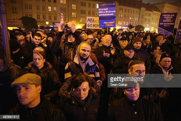 Supporters of the AfD political party attend a rally to protest against German Chancellor Angela Merkel's liberal policy towards taking in migrants...
