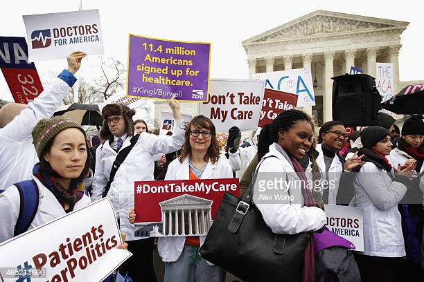 Supporters of the Affordable Care Act gather in front of the US Supreme Court during a rally March 4 2015 in Washington DC The Supreme Court was...