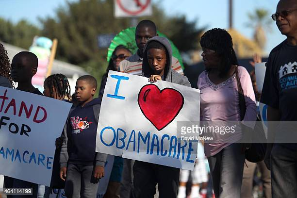 Supporters of the Affordable Care Act march in the 29th annual Kingdom Day Parade on January 20 2014 in Los Angeles California The Kingdom Day Parade...