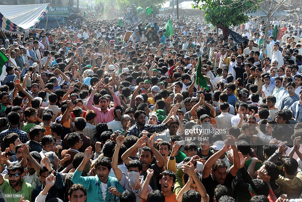 Supporters of the All Parties Hurriyat Conference (APHC) shout slogans during a rally in Srinagar on May 21, 2010. Thousands of people turned out to pay tribute to two slain separatist leaders in Indian Kashmir, as a one-day strike called to mark the occasion closed shops and businesses. The strike was called by the moderate faction of the Himalayan region's main separatist alliance, the All Parties Hurriyat Conference, to remember Molvi Mohammed Farooq and Abdul Gani Lone. AFP PHOTO/Rouf BHAT
