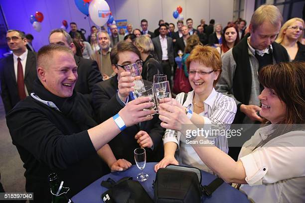 Supporters of the Alternative fuer Deutschland celebrate after strong initial exit poll results in SaxonyAnhalt state elections that will likely give...