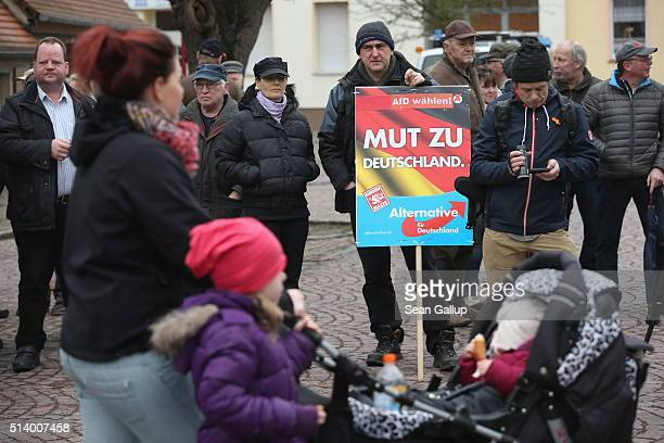 Supporters of the Alternative fuer Deutschland political party including one man holding a sign that reads 'Courage to Germany' arrive for an AfD...