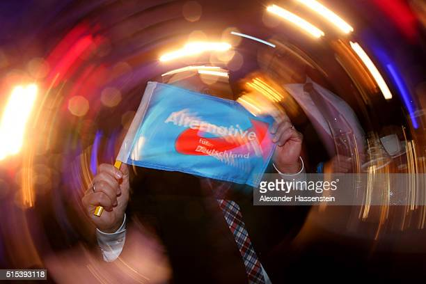 Supporters of the Alternative fuer Deutschland react to initial results in BadenWuerttemberg state elections at the AfD Election Party at Alte...