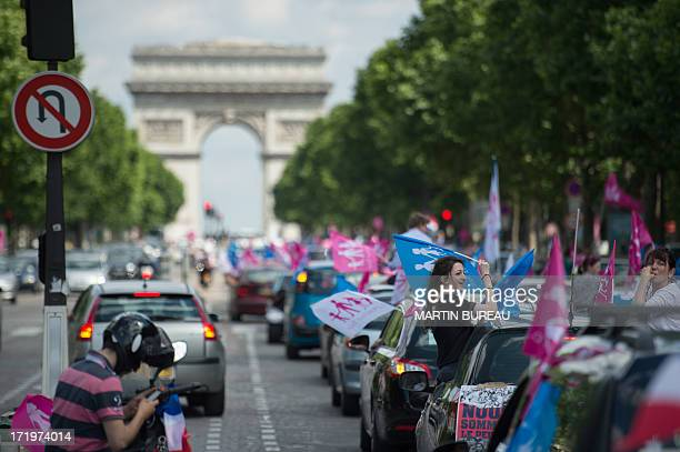 Supporters of the antigay marriage movement ''La Manif Pour Tous'' drive towards the Arch of Triumph on the ChampsElysees avenue in Paris on June 30...