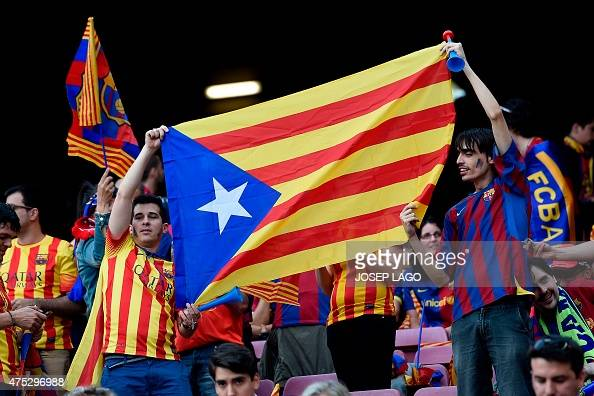 Supporters of the Athletic Bilbao wave a Catalan independentist flag 'Estelada' prior to the Spanish Copa del Rey final football match Athletic Club...