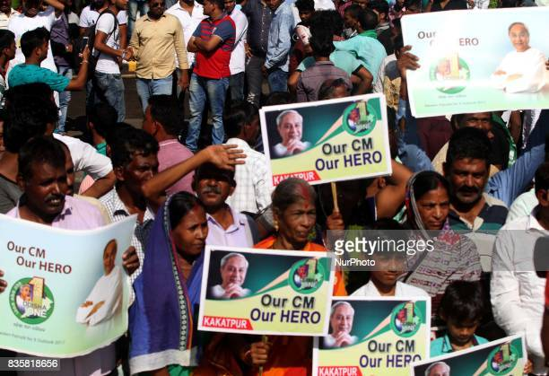 Supporters of the Biju Janata Dal political party stands on wayside outside of the Biju Patnaik International airport in Bhubaneswar as they wait to...