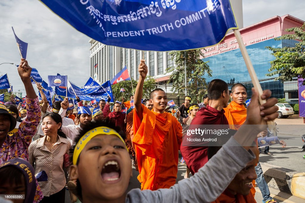 Supporters of the Cambodia National Rescue Party march to Freedom Park to contest the Cambodian national election results on September 15, 2013 in Phnom Penh, Cambodia. The CNRP have planned a three-day demonstration in Freedom Park to contest the Cambodian national election results.