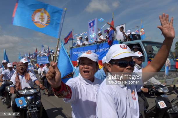Supporters of the Cambodian People's Party shout slogans on the last day of the commune election campaign in Phnom Penh on June 2 2017 A sea of...