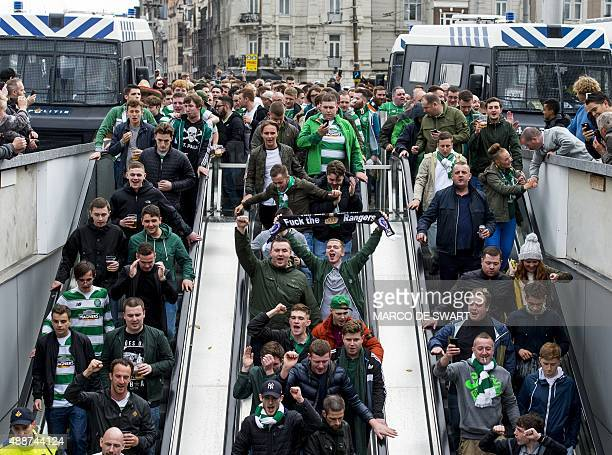 Supporters of the Celtic take escalators down at the Central Station in Amsterdam The Netherlands on September 17 on their way to the Arena stadium...