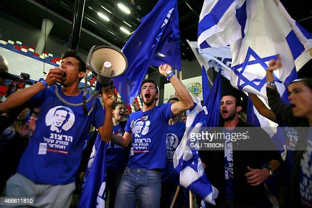 Supporters of the centreleft Zionist Union party take part in early celebrations outside the party's headquarters as they wait for the announcement...