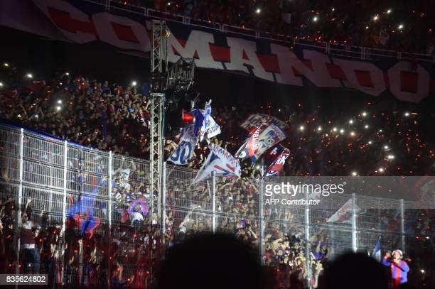 Supporters of the Cerro Porteno football club attend the inauguration of the new Cerro Porteno club stadium on August 19 2017 in Asuncion Paraguay /...