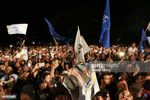 Supporters of the PAN coalition celebrate their victory in Pristina Kosovo on early June 12 2017 After 90 percent of the votes were counted in the...