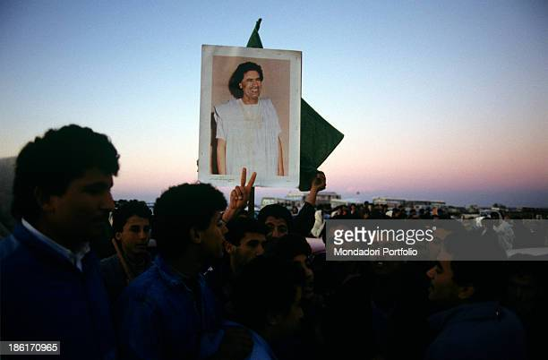 Supporters of the Colonel Muammar Gaddafi head of the Libyan state gathered at dusk for the press conference on the Rabta factory which is accused of...