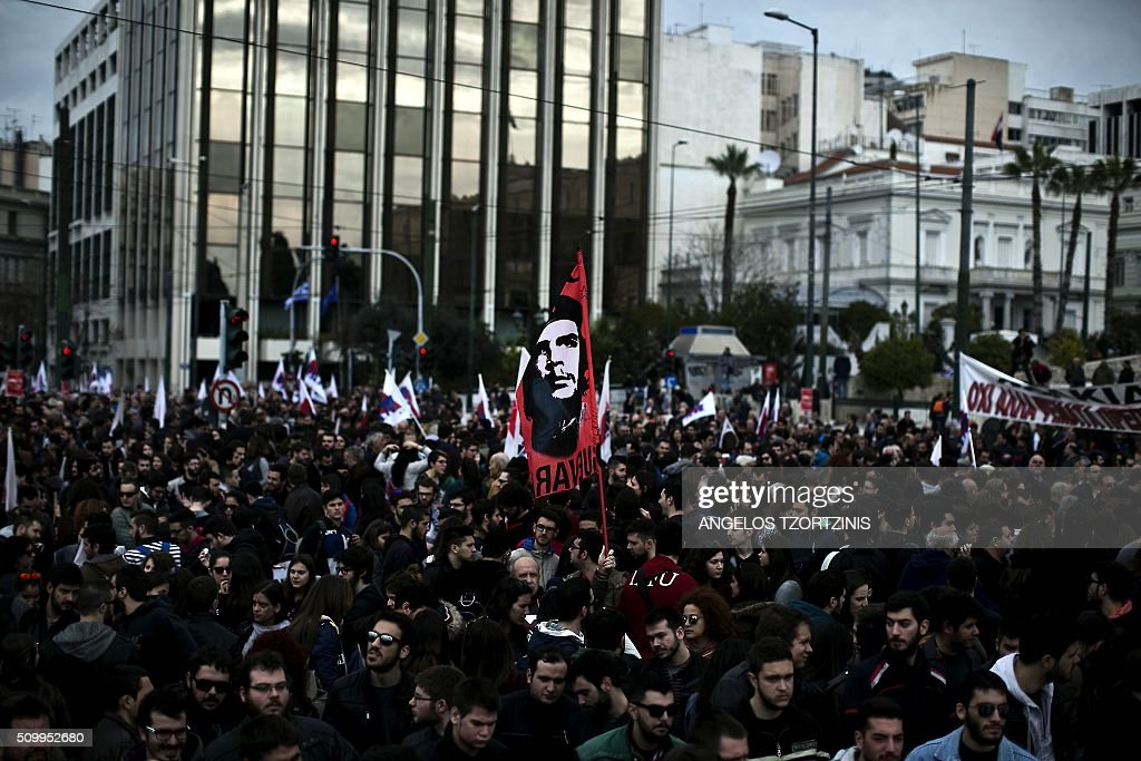 Supporters of the Communist-affiliated trade union PAME and Greek farmers take part in a protest against pension reform and tax issues, on February 13, 2016 in Athens. Thousands of protesters, especially Supporters of the Communist-affiliated trade union PAME and farmers have again demonstrated on February 13 in Syntagma Square in Athens against a controversial project of pension reform. / AFP / ANGELOS TZORTZINIS