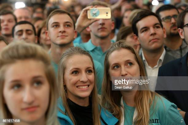 Supporters of the conservative Austrian People's Party react to initial results that give the party a first place finish and 302% of the vote in...