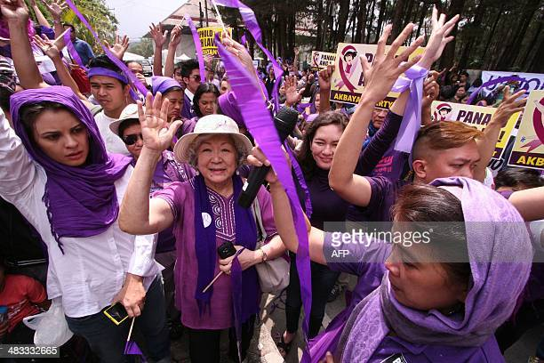 Supporters of the controversial birth control or Reproductive Health law celebrate in front of the court's summer residence in Baguio City Trinidad...