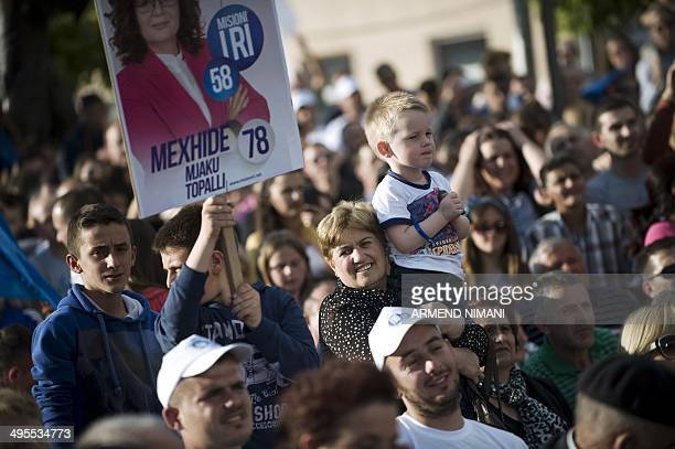 Supporters of the Democratic Party of Kosovo gather during an electoral campaign rally for Kosovo's Prime Minister and leader of the Democratic Party...
