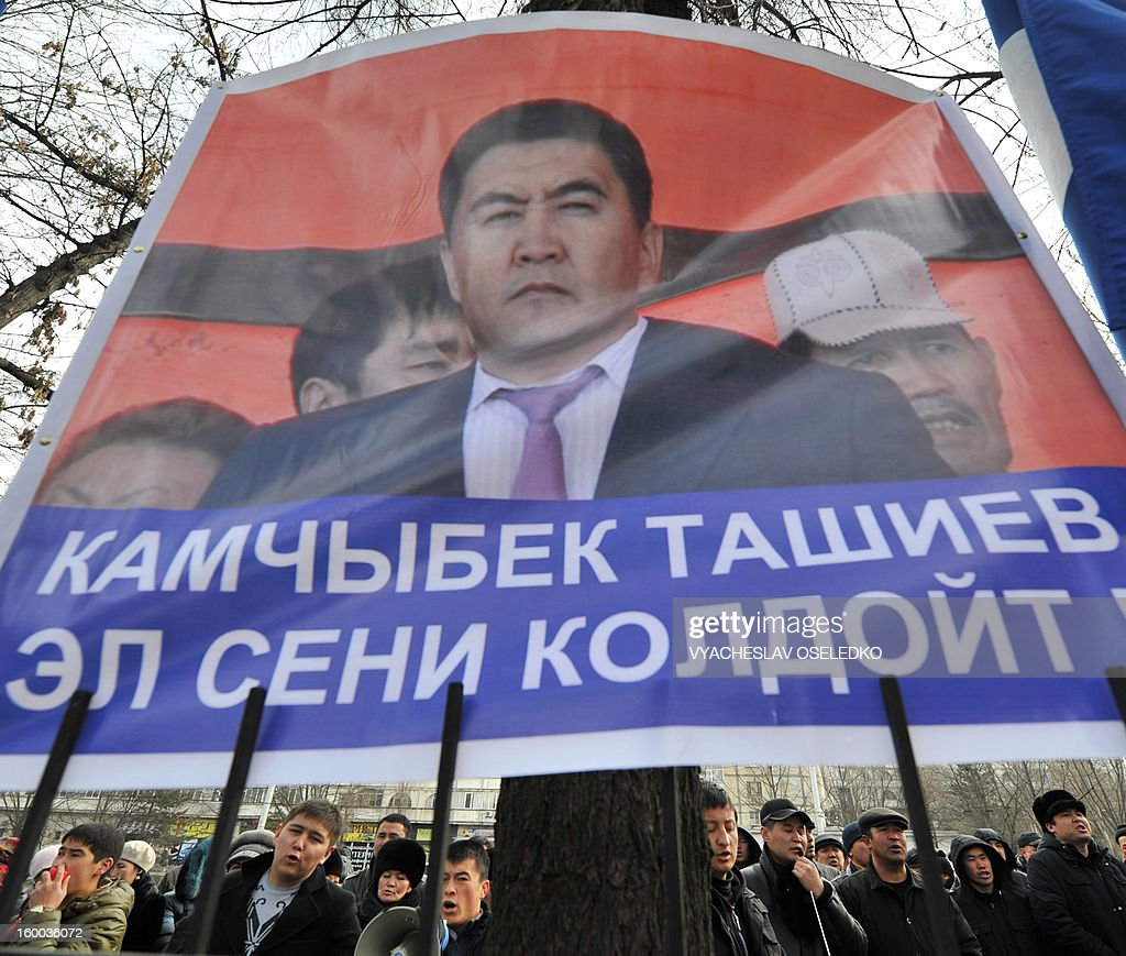 Supporters of the detained opposition lawmakers protest in front of a court in the Kyrgyzstan's capital Bishkek on January 25, 2013. The banner reads: 'Kamchybek Tashiev, people trust you!' The head of nationalist opposition Ata-Zhurt party Kamchybek Tashiev was arrested last year along with two other lawmakers over their role in a protest on the previous day demanding the nationalisation of the Canadian-owned Kumtor mine. AFP PHOTO / VYACHESLAV OSELEDKO