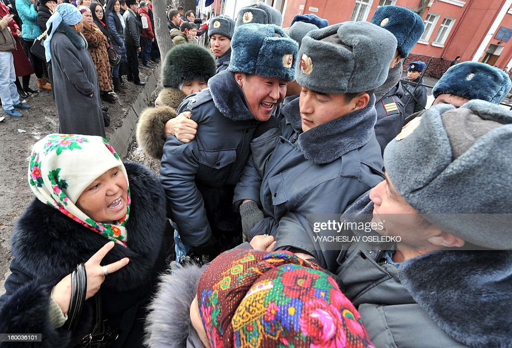 Supporters of the detained opposition lawmakers protest in front of a court in the Kyrgyzstan's capital Bishkek on January 25, 2013, during the lawmakers' trial. The head of nationalist opposition Ata-Zhurt party Kamchybek Tashiev was arrested last year along with two other lawmakers over their role in a protest on the previous day demanding the nationalisation of the Canadian-owned Kumtor mine.