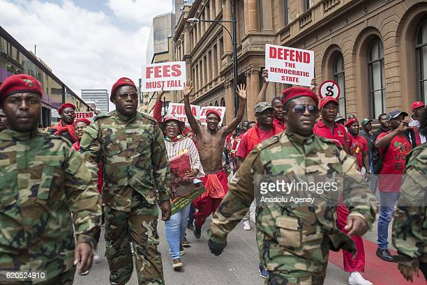 Supporters of the Economic Freedom Fighters Party take part in a protest demanding resignation of South African President Jacob Zuma towards the...