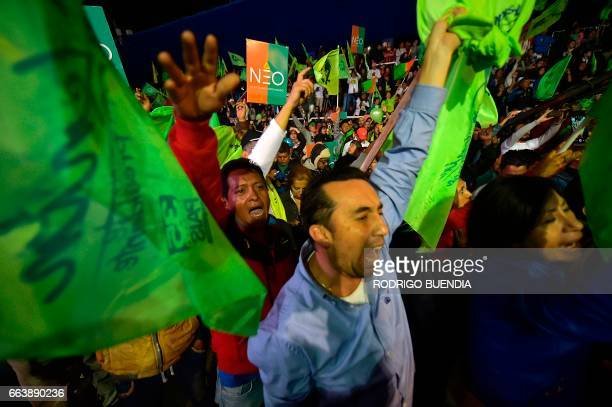 Supporters of the Ecuadorean presidential candidate of the ruling Alianza PAIS party Lenin Moreno celebrate although the official results of the...