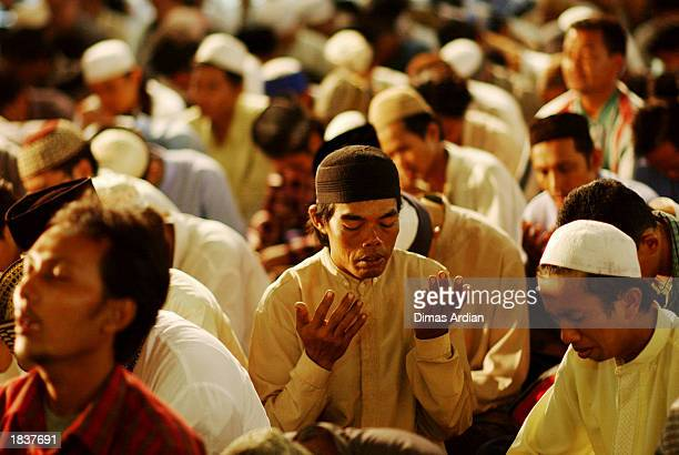 Supporters of the famous Indonesian Muslim preacher Abdullah Gymnastiar aka Aa Gym pray for peace at Istiqlal Mosque the biggest mosque in Indonesia...