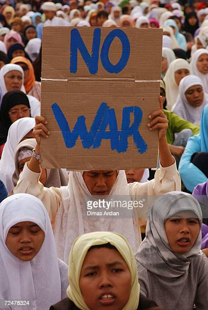 Supporters of the famous Indonesian Muslim preacher Abdullah Gymnastiar aka Aa Gym gather at a peace demonstration March 2003 in Jakarta Indonesia At...