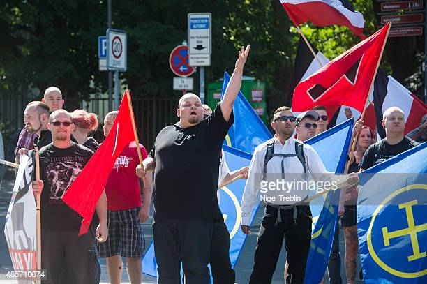 Supporters of the farright 'Die Rechte' political party gather to protest against the welcome policy towards foreign migrants of Goslar town Mayor...
