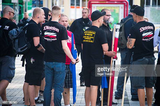 Supporters of the farright ÒDie RechteÓ political party gather to protest against the welcome policy towards foreign migrants of Goslar town Mayor...