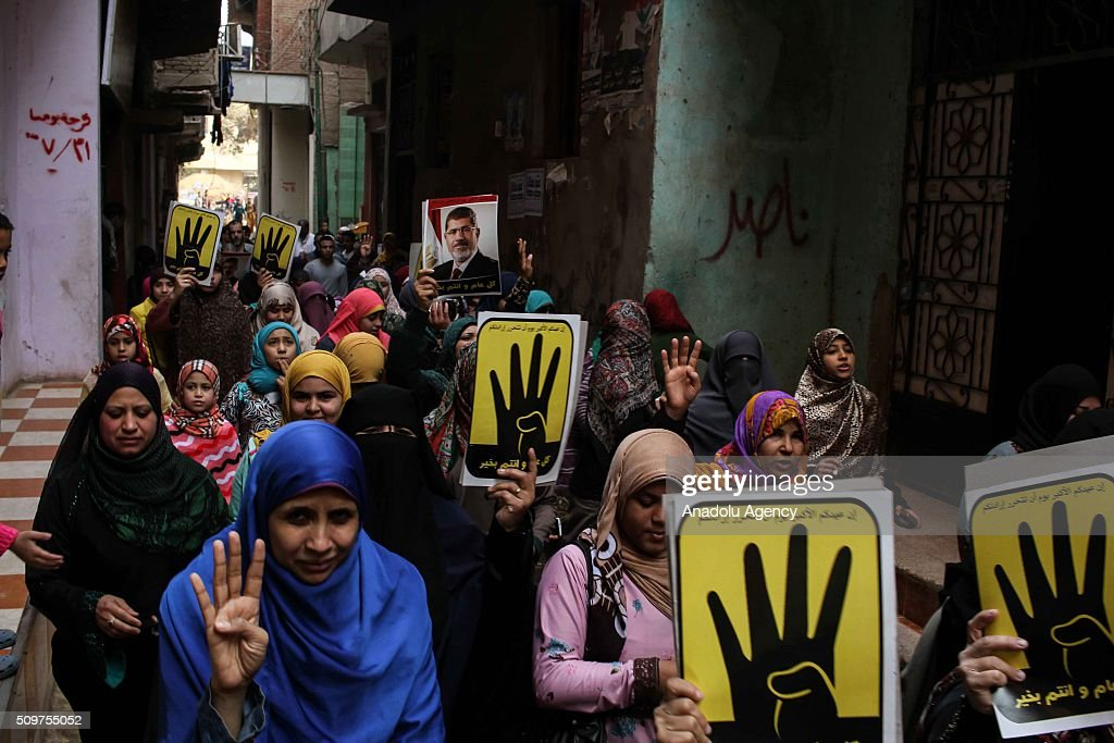 Supporters of the former President of Egypt Mohamed Morsi raise their hands with the Rabia gestures and hold rabia banners during a demonstration against Egyptian administration in Giza, Egypt on February 12, 2016.